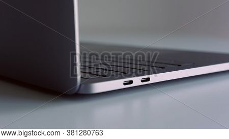 Close Up Side View Of Silver Laptop On White Table. Action. New Portable Computer Details With Usb P