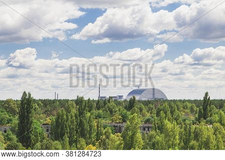 Pripyat, Ukraine, August 2020: Pripyat Is Overgrown With A Wild Forest And A Sarcophagus Is Visible