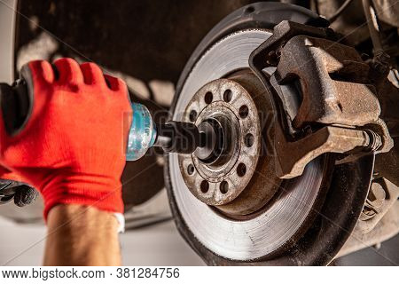 Close Up Hand A Man Change Bearing Of Wheel In The Car Maintenance Concept
