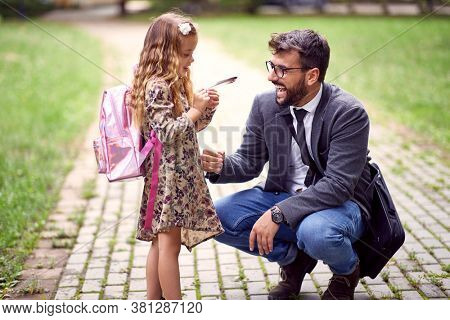 Father and daughter spending leasure time together in a park