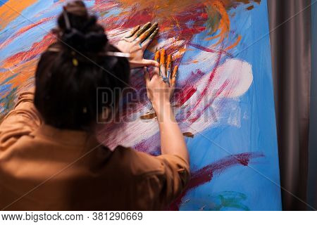 Woman With Painted Hands On Large Canvas In Art Workshop. Modern Artwork Paint On Canvas, Creative,