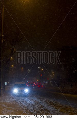Winter Snow Storm. Traffic Jam At Night. Car Blurred At The Street.