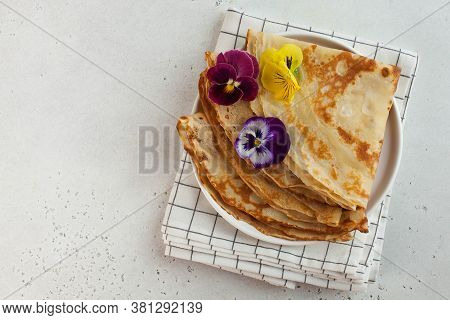 French Crepes, Pancakes Decorated With Flowers. Concept Of Breakfast, Dessert. Copy Space. French Cu