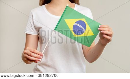 Brazil Flag. Football Fan. Woman In White Holding Official Symbol With Green Yellow Diamond Blue Glo