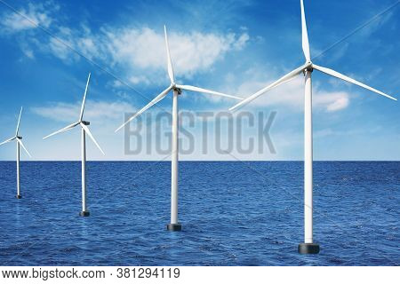 Floating Wind Turbines Installed In Sea Under Blue Sky. Alternative Energy Source