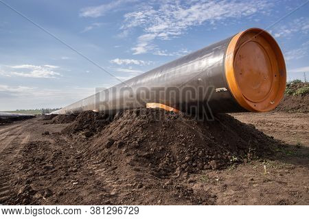 Gas And Oil Pipeline Construction. Pipes Welded Together. Big Pipeline Is Under Construction.