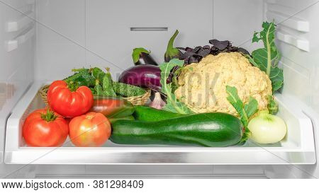 Shelf In The Refrigerator With Vegetables. Open Refrigerator Full Of Vegetables. Healthy Food. Healt