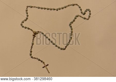 The Image Of A Rosary Or Catholic Third And A Crucifix Pendant At Its End And Another Of Buddhism. R