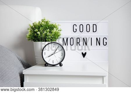 Good Morning Concept - Alarm Clock, Houseplant And Lightbox With