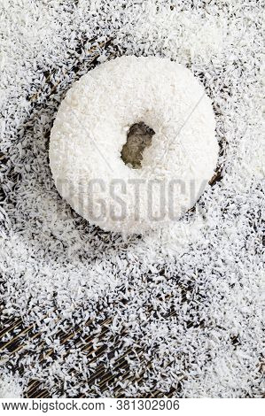 Delicious And Fresh White Doughnut In Coconut And With Coconut Filling, Closeup Of A Ready-made High