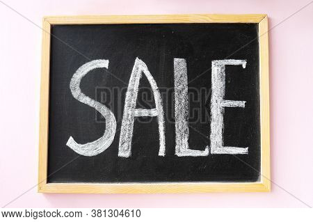 Text Sale With Chalk, Announcement On Black Wooden Board, Blackboard, Chalkboard, Frame. Pink Backgr
