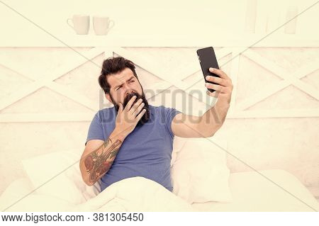 Taking Selfie. Cellular Communication. Modern Guy Talking On Smartphone In Bed. Modern Technology Fo