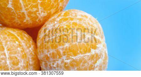 Flesh Of Sweet And Ripe Orange Close-up, Useful Citrus Fruit, Orange On A Blue Background