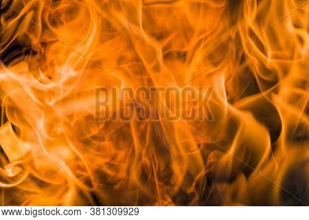 Orange With Warm Colors Flames From The Fire, Close-up Of The Dangerous Phenomenon