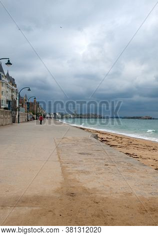 St Malo, France - September 13, 2018: People Walking Along Promenade At Seafront In Saint Malo, Brit