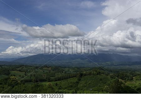Landscape View With Green Forest During Rainy Season In Thailand.