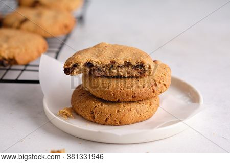 Oatmeal Cookies With Raisins And Nuts On A White Background.