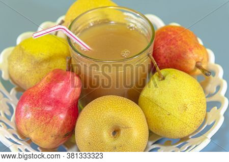 Pear Fruit Juice (pyrus Spp) On White Tray And Blue Background