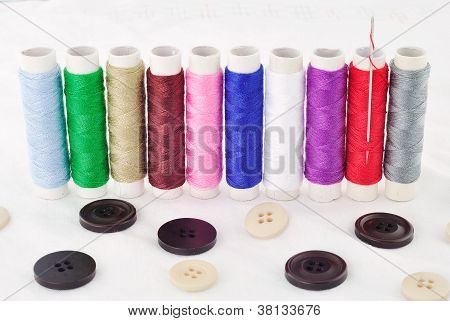 Bobbins Of Thread And Clasper