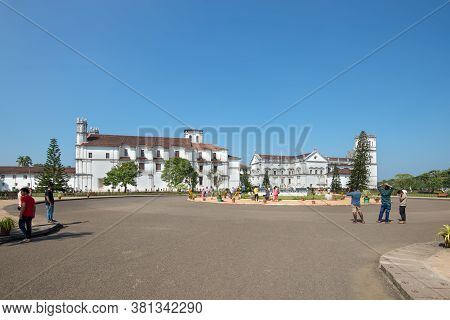 Old Goa, India - November 23, 2019: Tourists In Front Of The Catholic Church Of St. Francis Of Assis