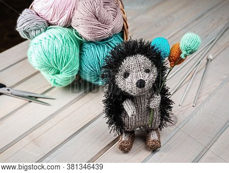 Knitted Hedgehog With Balloons. Knitted Handmade Toys. Amigurumi. Hand Made.