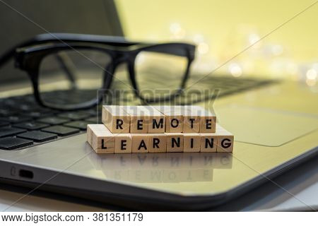 Remote Learning Virtual Learning Concept With Wood Block Letters On Laptop.  Distance Learning, Remo