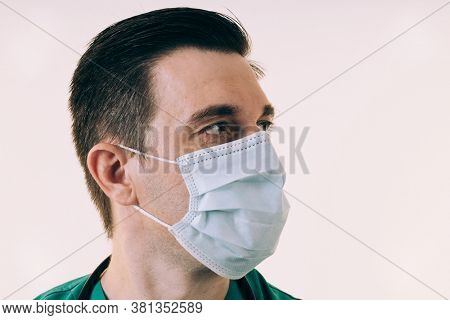 Portrait of young male doctor wearing a medical face mask