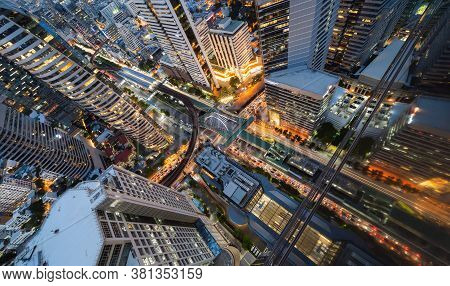 Aerial View Of Sathorn Intersection Or Junction With Cars Traffic, Bangkok Downtown. Thailand. Finan