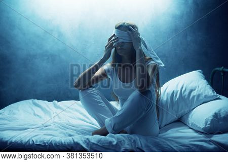 Blindfolded psycho woman in bed, psychedelic