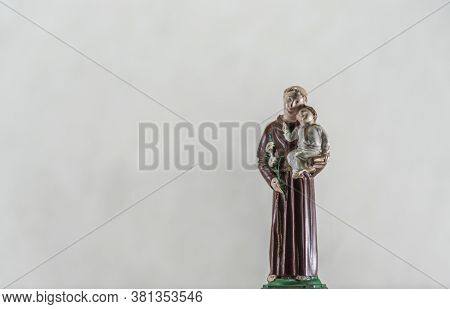 Image Of Catholic Saints Where Saint Anthony Appears With Jesus On His Lap On A Light Background
