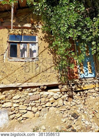 An Old Village House In Amasya. Mudbrick Wall. Adobe Houses.