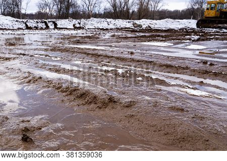 Texture Of A Dirty Bad Dirt Road Dirt Road With Puddles And Clay Drying Mud With Cracks And Ruts. Of