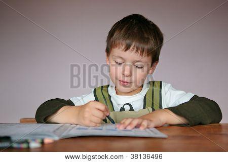 Cute little boy learning to write