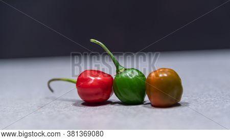 Fruits Of Goat Pepper (capsicum Chinense) On Dark Background