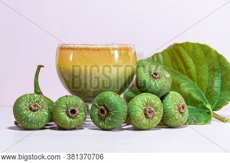 Fruits And Garden Fig (ficus Auriculata) Juice On Pink Background