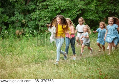 Carefree. Kids, Children Running On Green Forest. Cheerful And Happy Boys And Girs Playing, Laughtin