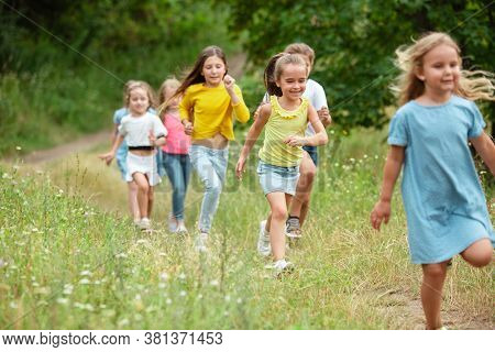 Memories. Kids, Children Running On Green Forest. Cheerful And Happy Boys And Girs Playing, Laughtin