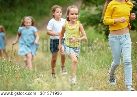 Summer. Kids, Children Running On Green Forest. Cheerful And Happy Boys And Girs Playing, Laughting,