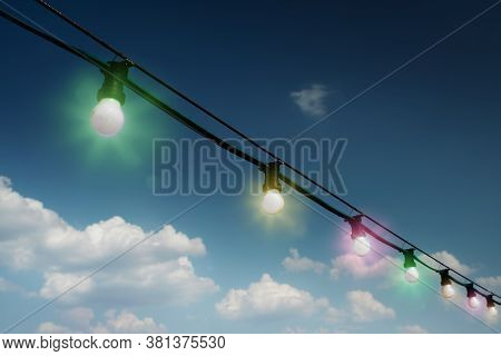 Colorful Outdoors String Lights Or Fiesta Lights Against Sky