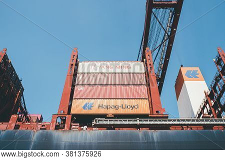2020-08-16 Hamburg, Germany: Low Angle View Of Large Cargo Containers On Container Ship Operated By