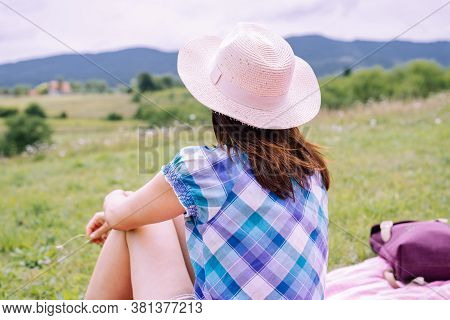 Beautiful Woman With Hat Relaxing In Nature. Happy People Lifestyle. Woman Having Picnic In Meadow.