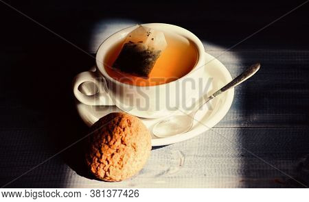 Relaxing Chamomile Tea. Cup Mug Hot Tea And Oat Cookie. Quick Snack Concept. Mug Filled Tea Close Up