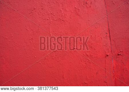 Texture Of Rough Concrete Wall Covered And Painted Red Decorative Stucco. Background Of Blood-red Co