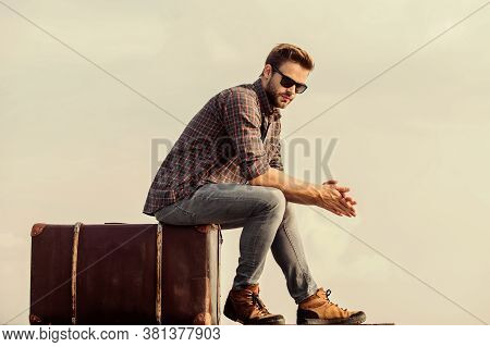 Adventure Awaits. Male Fashion Style. Looking So Trendy. Macho Man Unshaven Face Sit On Tour Bag. Bu