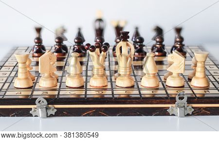 Black And White Chess Pieces Arranged On Chess Board Before Start Of Gameplay As Two Armies In Front