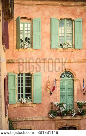 Vertical Close-up Picture Of Town Hall In Roussillion, Provence, France. Old Historical Building Wit