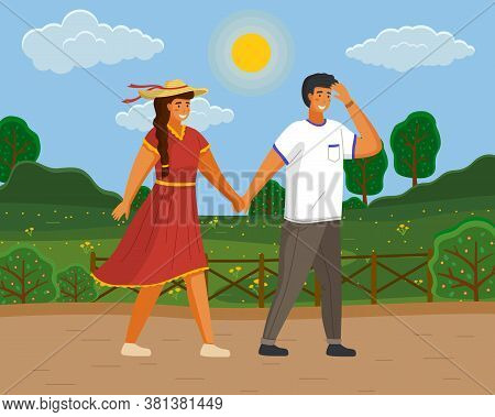 Couple Walking In A Park. Young Guy And Girl Wearing A Light Dress And A Straw Hat Holding Hands Wal