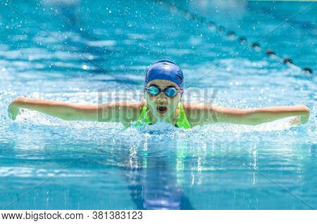 Chiang Mai, Thailand - 10 October - Young Female Swimmer Swims Her Butterfly Stroke During Her Swim