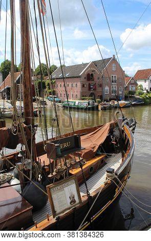 Dokkum, Netherlands, 22 July 2020: Historic Boat And View Of \'het Groot Diep\' Canal In Dokkum. It