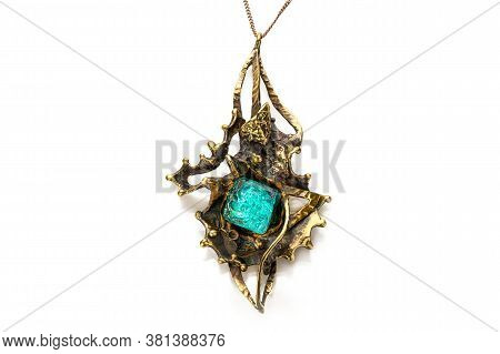 Krasnoyarsk, Russia, August 16, 2020: Womens Pendant With A Green Stone, Handmade Jewelry. Isolate O